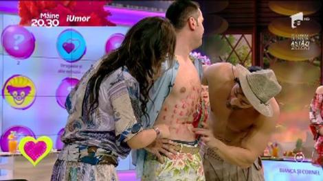 O provocare fierbinte la 2k1!Victor Slav şi Cornel Păsat au fost înroşiţi de pupici pe abdomene de soţiile lor!