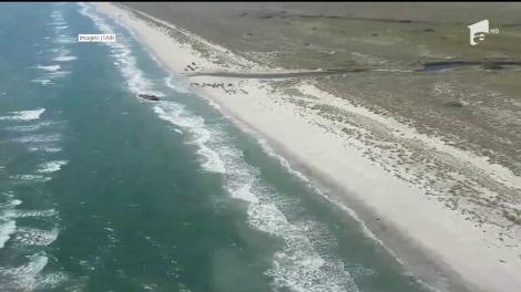 Încă un pescador plin cu migranţi a eşuat pe o plajă românească