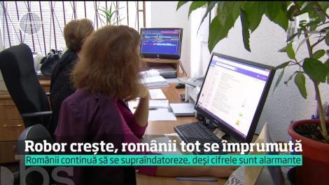 ROBOR crește, românii tot se împrumută. Analiştii trag un semnal de alarmă şi spun că acestă economie artificială e o bombă cu ceas