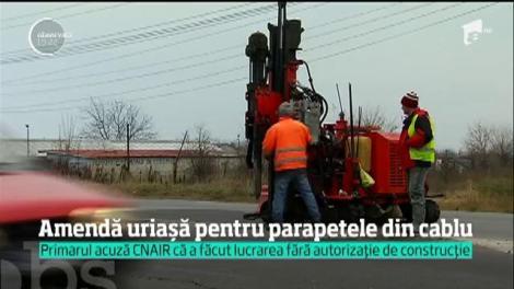 S-au încins spiritele, în Afumaţi, din cauza unui parapete montat pe mijlocul drumului. Primarul acuză CNAIR că a făcut lucrarea fără autorizație de construcție