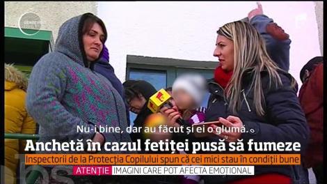 Anchetă în cazul fetiţei de doi ani din Tulcea, încurajată de părinţi să fumeze şi să bea cafea