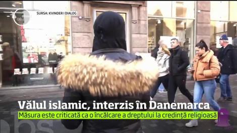 Parlamentul din Danemarca a adoptat o lege care interzice purtarea vălului islamic şi a altor piese vestimentare care acoperă feţele