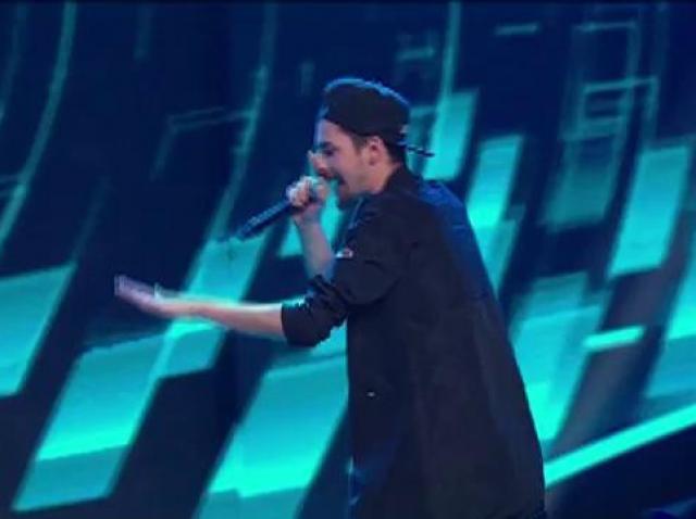 KIO are deja colaborări cu nume mari ale muzicii românești și vrea un scaun de-al celor 4. Va reuși, oare, să convingă jurații?! Vine să-l răzbune pe Fratele Lu Chan cu o rugăciune pe note