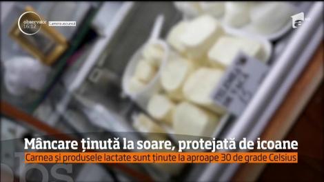 """FOCAR DE INFECȚIE într-o piață din Capitală! Carnea şi lactatele, """"protejate"""" doar de icoane"""