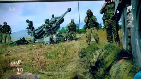 Smiley News. Glume militare: Un soldat este trezit cu tunul