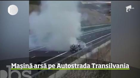 Aproape de tragedie, pe Autostrada Transilvania. O mașină în flăcări a explodat în timp ce doi pompieri încercau să stingă focul