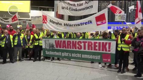 Sute de zboruri au fost afectate pe opt aeroporturi din Germania, din cauza unei noi greve a personalului de securitate!