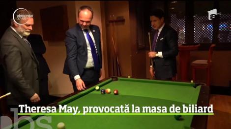 Theresa May va luat parte la o lecţie de biliard în timpul vizitei sale la summitul dintre UE şi Liga Arabă