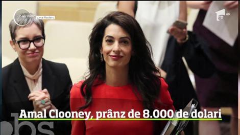 Un student la drept a plătit peste 8 mii de dolari pentru a lua prânzul cu soţia lui George Clooney