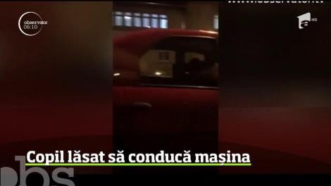 Scene incredibile au fost surprinse pe un bulevard din Braşov! Aici, un băieţel a fost filmat la volanul unei maşini aflată în mers