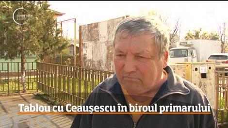 Un primar din Prahova este anchetat de poliţie, după ce şi-a agăţat pe peretele din birou un tablou cu Ceauşescu