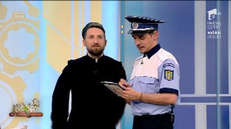 Polițistul Răzvan Simion îl trage pe dreapta pe Dani Oțil, preotul de la Neatza: Nu atingeți organul, vă rog să-mi prezentați actele!