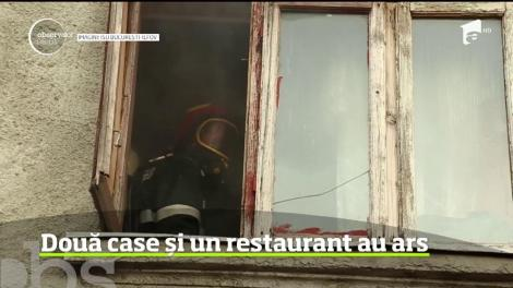 """Incendiu devastator în București. Două case și un restaurant de lux au luat foc. 11 familii au privit cum tot ce aveau s-a făcut scrum: """"Putea să moară tot cartierul"""""""