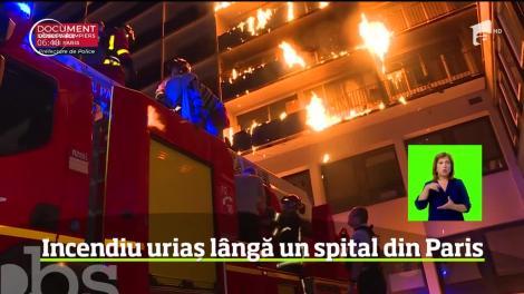 O femeie a murit, iar alte opt persoane au fost rănite într-un incendiu care a devastat un bloc de locuinţe de la periferia Parisului