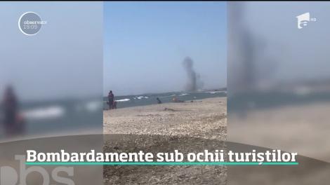Pe litoral, ca la război! Aşa s-au simţit mai mulţi turişti aflaţi pe plaja de la Vadu. Au privit înspăimântaţi mai multe explozii puternice