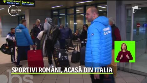 Sportivii români s-au întors acasă din Italia. Conducerea îi ameninţă cu demiteri, dacă cumva se gândesc să nu mai vină la serviciu