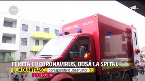 Primele imagini din Timișoara, de la domiciliul femeii diagnosticate cu coronavirus. Pacienta a fost scoasă din casă cu izoleta - VIDEO