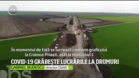 Într-o lume închisă, un drum expres Craiova-Pitești e deschis. Pentru muncitori şi utilaje. Şi se lucrează la foc continuu pentru a fi gata la timp