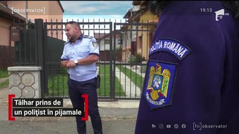 Uniforma în casă, iar poliţistul pe stradă, în pijamale. Un agent a sărit direct din pat pentru a salva o femeie