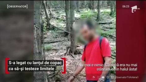 Un tânăr s-a legat cu lanțul de copac ca să-și testeze limitele