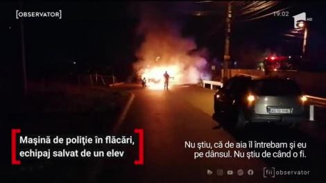 Doi poliţişti şi un jandarm, captivi într-o maşină de poliţie în flăcări, au fost salvaţi de un elev
