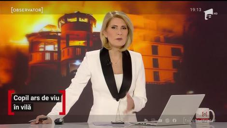 Copil ars de viu în vila mistuită de flăcări