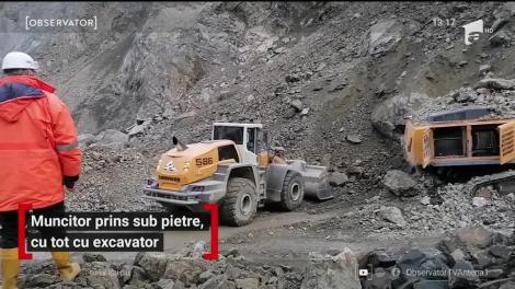 Muncitor prins sub pietre, cu tot cu excavator, în Cluj