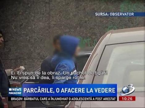 Şoferii din Bucureşti, şantajaţi de parcagii, sub ochii poliţiştilor